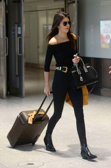 Kendall Jenner in Black Skinny Jeans & Off Shoulder Black Top